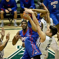 Jan 17, 2016; New Orleans, LA, USA; Tulane Green Wave center Ryan Smith (15) blocks a shot by Southern Methodist Mustangs forward Ben Moore (00) during the second half of a game at the Devlin Fieldhouse. Southern Methodist defeated Tulane 60-45. Mandatory Credit: Derick E. Hingle-USA TODAY Sports