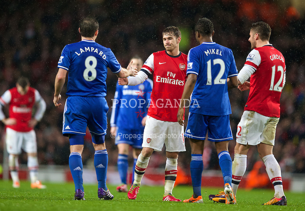 LONDON, ENGLAND - Monday, December 23, 2013: Arsenal's Aaron Ramsey is thanked by Chelsea's Frank Lampard for putting the ball out of play with a Chelsea player injured during the Premiership match at the Emirates Stadium. (Pic by David Rawcliffe/Propaganda)