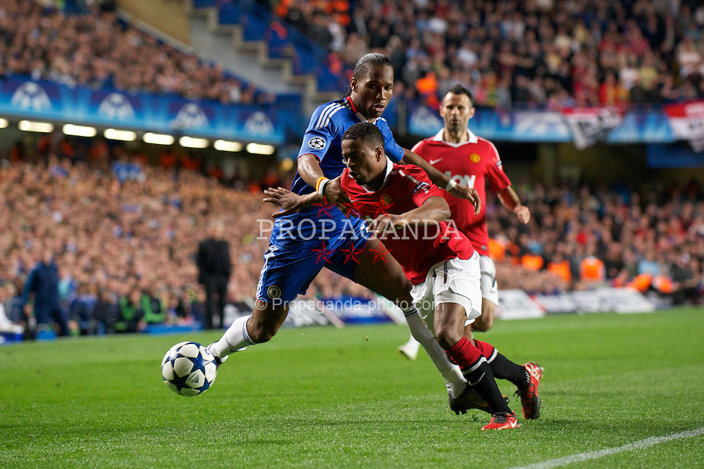 LONDON, ENGLAND, Wednesday, April 6, 2011: Chelsea's Didier Drogba and Manchester United's Patrice Evra during the UEFA Champions League Quarter-Final 1st leg match at Stamford Bridge. (Photo by David Rawcliffe/Propaganda)