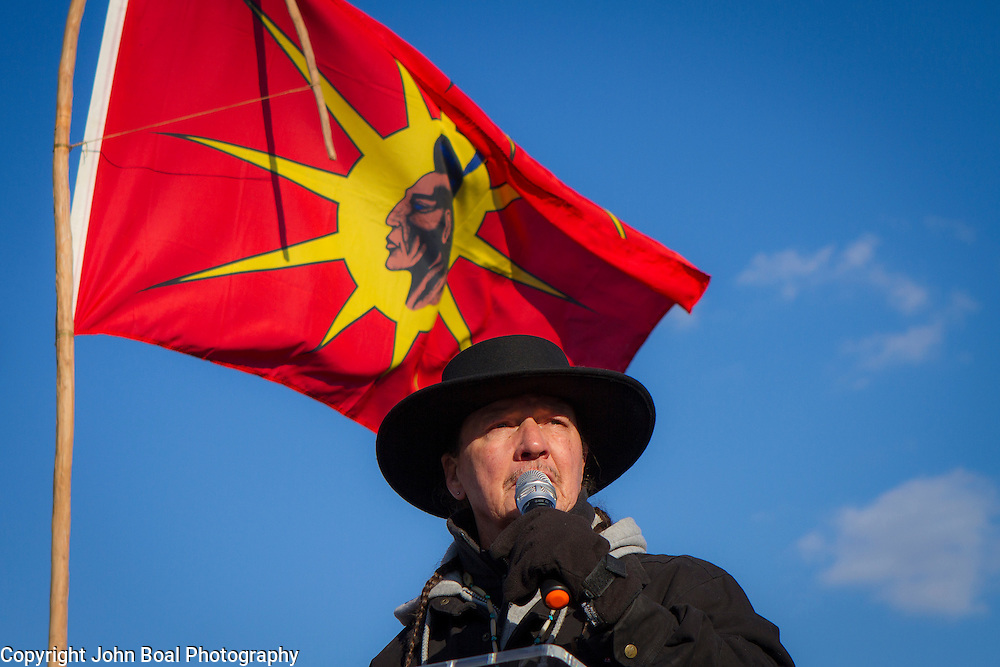 Gray Michael Parsons, Machapunga Tuscarora, spoke during a protest and march from in front of the U.S. Capitol to the EPA, about the North Dakota Access Pipeline, as well as the effort to free Leonard Peltier.  Saturday, December 10, 2016. John Boal Photography