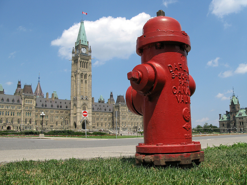 Red coloured fire hydrant on the Parliament Hill in Ottawa, Ontario, Canada.