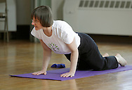 Middletown, New York - Instructor Maria Blon of Create Your Wellness leads a yoga class at the First Presbyterian Church on April 21, 2011.