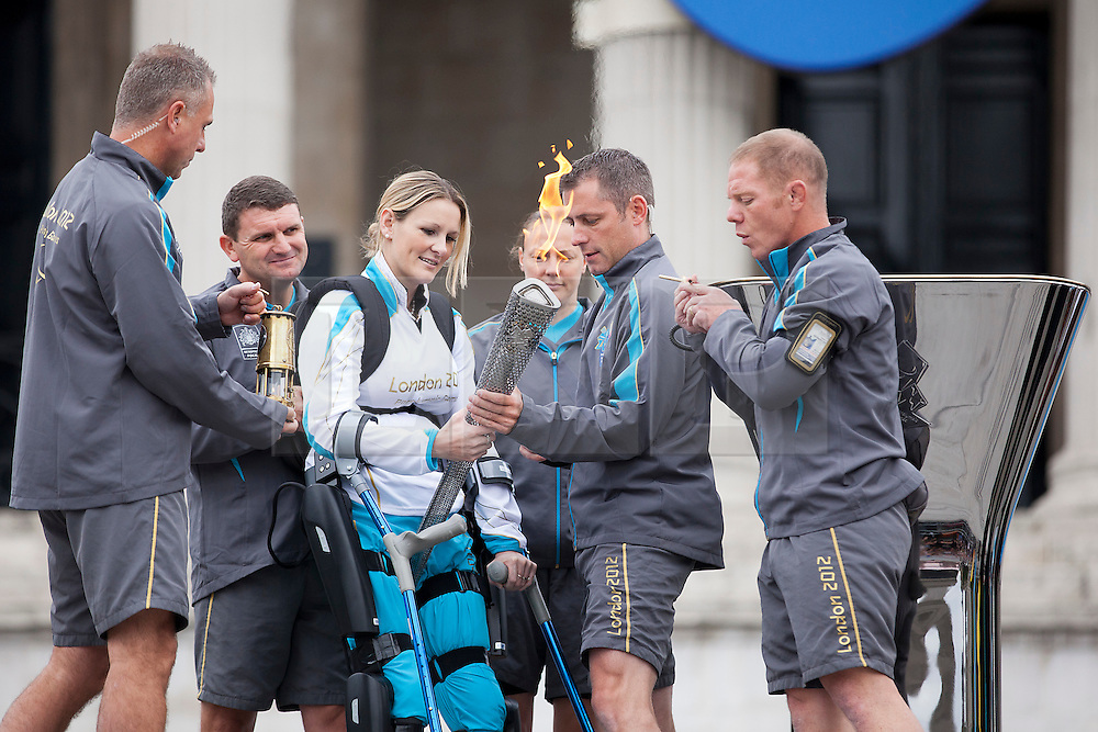 © Licensed to London News Pictures. 24/08/2012. LONDON, UK. Claire Lomas holds the Paralympic Torch  as she prepares to light the Paralympic Cauldron in Trafalgar Square today (24/08/12). Ms Lomas, formerly a horse event rider, was paralysed from the chest down after being injured during the Osberton Horse Trials and completed the London Marathon in 2012. Photo credit: Matt Cetti-Roberts/LNP