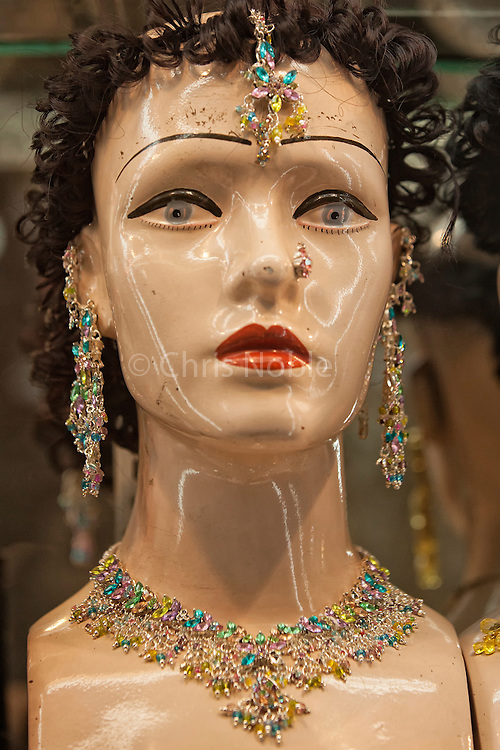 A mannequin models the latest jewelry in a storefront in the Old City of Varanasi India.