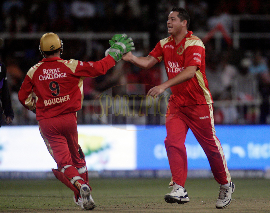 DURBAN, SOUTH AFRICA - 1 May 2009. Mark Boucher and Jesse Ryder during the IPL Season 2 match between Kings X1 Punjab and the Royal Challengers Bangalore held at Sahara Stadium Kingsmead, Durban, South Africa..