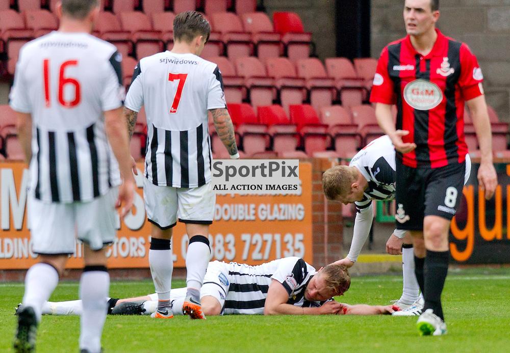 Dunfermline Athletic v Airdrieonians SPFL League One Season 2015/16 East End Park 26 September 2015<br /> Marc McAusland picks up a head knock<br /> CRAIG BROWN | sportPix.org.uk