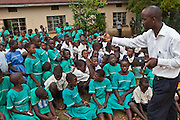 Andrew Kaggwa the community nurse from Bwindi community hospital leads a health education and nutrition training session with classes P 3,4,5,6,7 at Nyamiyaga primary school.
