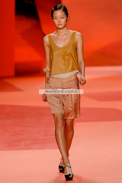 Hyoni Kang walks the runway wearing Phillip Lim women Spring 2010 collection during Mercedes-Benz fashion week on September 16, 2009.