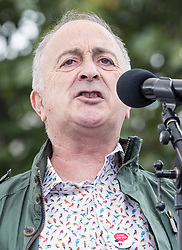© Licensed to London News Pictures. 06/09/2017. London, UK. Actor and activist Tony Robinson speaks to nurses during a demonstration in Parliament Square. The Royal College of Nursing is campaigning against the Government's one per cent cap on public sector pay. Photo credit: Peter Macdiarmid/LNP