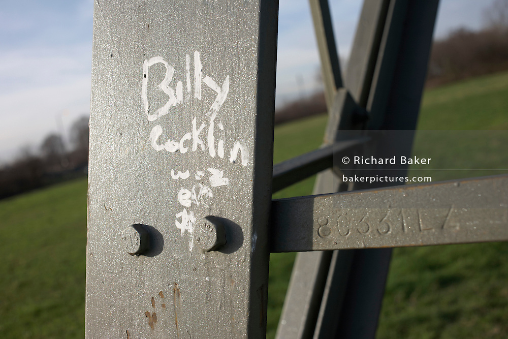 Billy Cocklin has painted woz ere on the aluminium leg of an electricity pylon near a housing estate in Beckton.