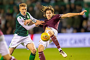 Vykintas Slivka (#8) of Hibernian FC and Peter Haring (#5) of Heart of Midlothian fight for the ball during the Ladbrokes Scottish Premiership match between Hibernian FC and Heart of Midlothian FC at Easter Road Stadium, Edinburgh, Scotland on 29 December 2018.