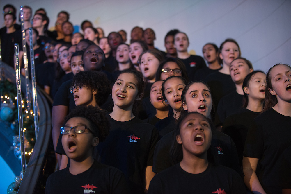 """The Chicago Children's Choir performs at the Field Museum as part of a SocialWorks holiday-themed event to benefit underprivileged youth and the homeless called """"A Night at The Museum"""" on December 20, 2017."""