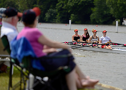 © Licensed to London News Pictures. 28/06/2012. Henley-on-Thames, UK Spectators watch rowing crews compete at the Henley Royal Regatta on June 28, 2012 in Henley-on-Thames, England. The 173-year-old rowing regatta is held 27th June- 1st July 2012. Photo credit : Stephen Simpson/LNP