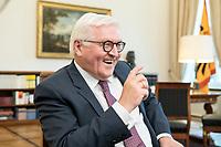 02 JUL 2018, BERLIN/GERMANY:<br /> Frank-Walter Steinmeier, Bundespraesident, waehrend einem Interview, Amtszimmer des Bundespraesidenten, Schloss Bellevue<br /> IMAGE: 20180702-01-059<br /> KEYWORDS: Bundespräsident, freundlich, lacht, lachen