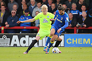 AFC Wimbledon defender George Francomb (7) taking on Peterborough United defender Lewis Freestone (32) during the EFL Sky Bet League 1 match between AFC Wimbledon and Peterborough United at the Cherry Red Records Stadium, Kingston, England on 17 April 2017. Photo by Matthew Redman.