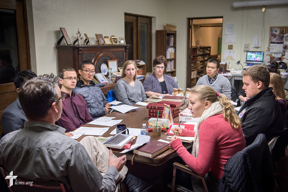 The Rev. Eric R. Andræ, associate pastor for campus and international ministry at First Trinity Evangelical–Lutheran Church and Luther House student center, leads his student Bible study before worship at the church on Sunday, Nov. 20, 2016, in Pittsburgh. Seated from the left of him around the table is, Brandon Price, Paul Brouwer, Hongshun Yang, Meredith Leech, Lyndsey Seibel, Anthony Jin, Kristi Nowak, Kimmie Seibel, Christa Orvik, Edward Terhune V, and Carleigh May. LCMS Communications/Erik M. Lunsford