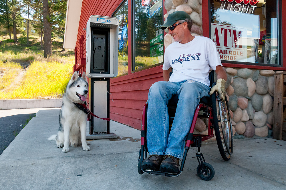 Nick Arnold, in his wheelchair  with his Siberian Husky dog, Sempi (term of respect for wise elder) at convenience store [406-420-2444]