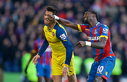 LONDON, ENGLAND - Saturday, February 21, 2015: Arsenal's Alexis Sanchez in action against Crystal Palace's Pape Souare during the Premier League match at Selhurst Park. (Pic by David Rawcliffe/Propaganda)