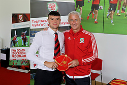 NEWPORT, WALES - Sunday, May 28, 2017: Callum Saunders receives a cap from Elite Performance Director Ian Rush for participation during day three of the Football Association of Wales' National Coaches Conference 2017 at Dragon Park. (Pic by Mark Roberts/Propaganda)