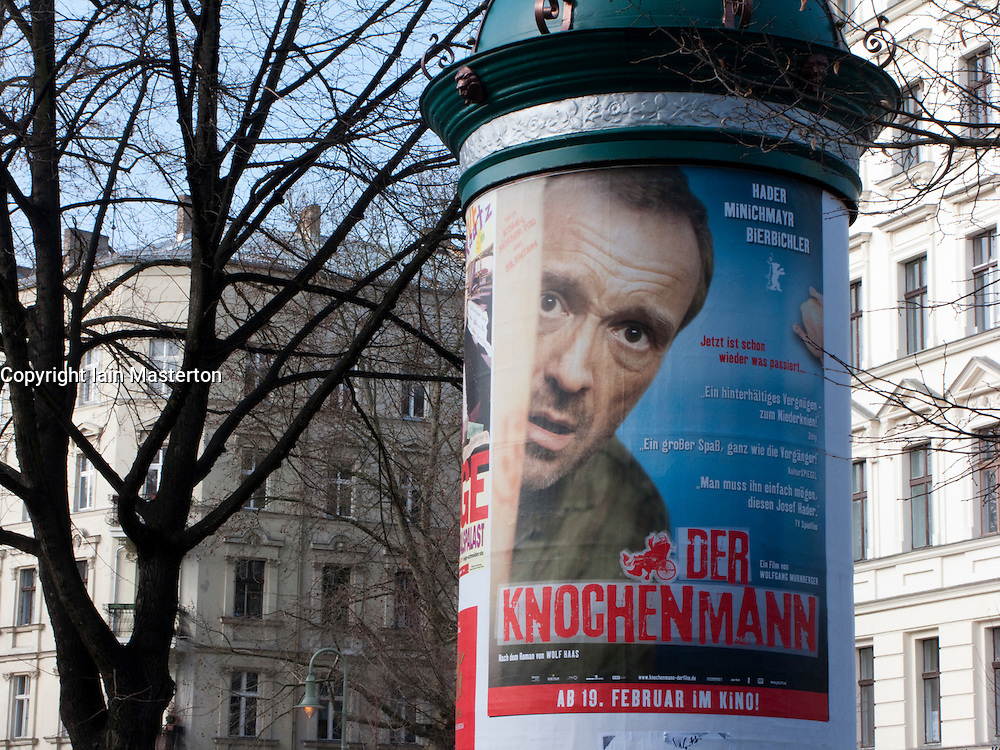 Movie poster stuck on advertising pillar in Prenzlauer Berg district of Berlin Germany 2009