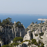 Calanques d'En Vau. La Calanque d'En-Vau est sans doutes une des plus belle et une des plus impressionnante des calanques avec de hautes falaises (c'est notamment un site d'escalade appr&eacute;ci&eacute;). La plage de sable et de galets plong&eacute;e dans un eau claire et turquoise.<br /> <br /> En Vau, the valley in provencal, is trapped between the mountains and the sea. The limpid water is of an emerald and turquoise color. Many climbers are attracted here due to the wide variety of climbs available, from beginners up to the most challenging stages. The Creek En-Vau is without doubt one of the most beautiful and most impressive of the creeks with high cliffs (notably a popular climbing site). The beach sand and pebbles embedded in a clear and turquoise water.