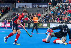 Hampstead & Westminster's Harry Martin sees his shot saved by Harry Gibson. Hampstead & Westminster v Surbiton - Men's Hockey League Final, Lee Valley Hockey & Tennis Centre, London, UK on 29 April 2018. Photo: Simon Parker