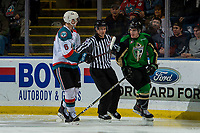 KELOWNA, CANADA - JANUARY 19:  Linesman Dustin Minty skates between Kaedan Korczak #6 of the Kelowna Rockets and Nolan Foote #29 of the Kelowna Rockets as they trash talk one another on January 19, 2019 at Prospera Place in Kelowna, British Columbia, Canada.  (Photo by Marissa Baecker/Shoot the Breeze)