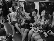 Hen party on the Piccadilly line. London. 26 August 2017