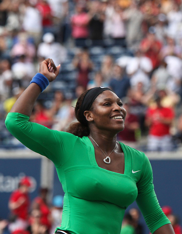 Serena Williams of the United States celebrates her victory over Samantha Stosur of Australia in the final at the Rogers Cup WTA event in Toronto, Ontario, August 14, 2011.<br /> AFP PHOTO/Geoff Robins