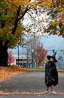 JEROME A. POLLOS/Press..Cianna Greatwalker-LaRock, 9, crosses Lakeside Avenue during Sorensen's Elementary's Halloween parade Friday. The entire school took a break from learning to show off their ghoulish and creative costumes.