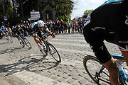 France April 13th 2014: The second group through Gruson included Geraint Thomas (#58), Tom Boonen, Omega Pharma, Team Sky's Bradley Wiggins and Garmin-Sharp's Sebastien Langeveld on the way to the finish in Roubaix Velodrome. Copyright 2014 Peter Horrell