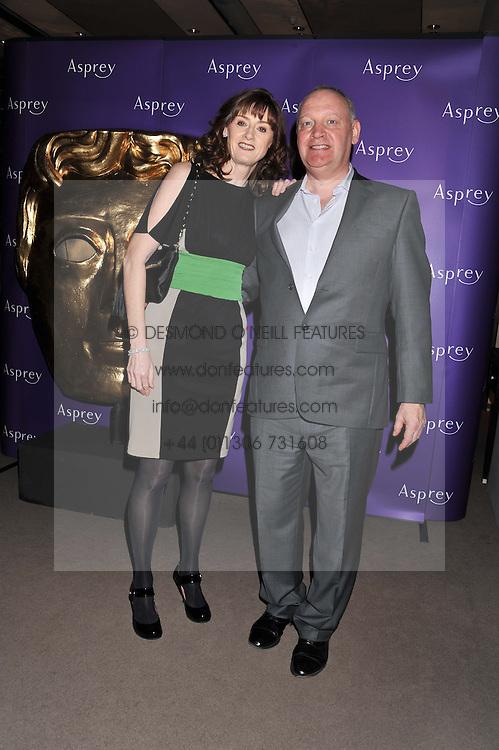 BAFTA chief executive AMANDA BERRY and ALISTAIR DIXON at the Asprey BAFTA Party held at Asprey, 167 New Bond Street, London on 11th February 2012.