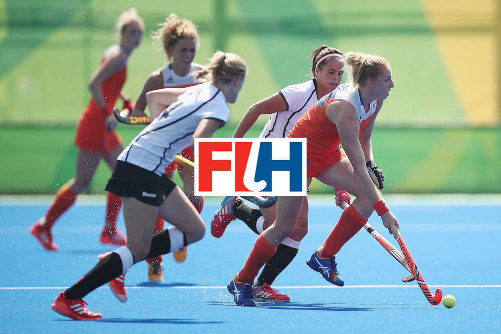 RIO DE JANEIRO, BRAZIL - AUGUST 17:  Margot van Geffen of the Netherlands runs the ball forward during the womens semifinal match between the Netherlands and Germany on Day 12 of the Rio 2016 Olympic Games at the Olympic Hockey Centre on August 17, 2016 in Rio de Janeiro, Brazil.  (Photo by Mark Kolbe/Getty Images)