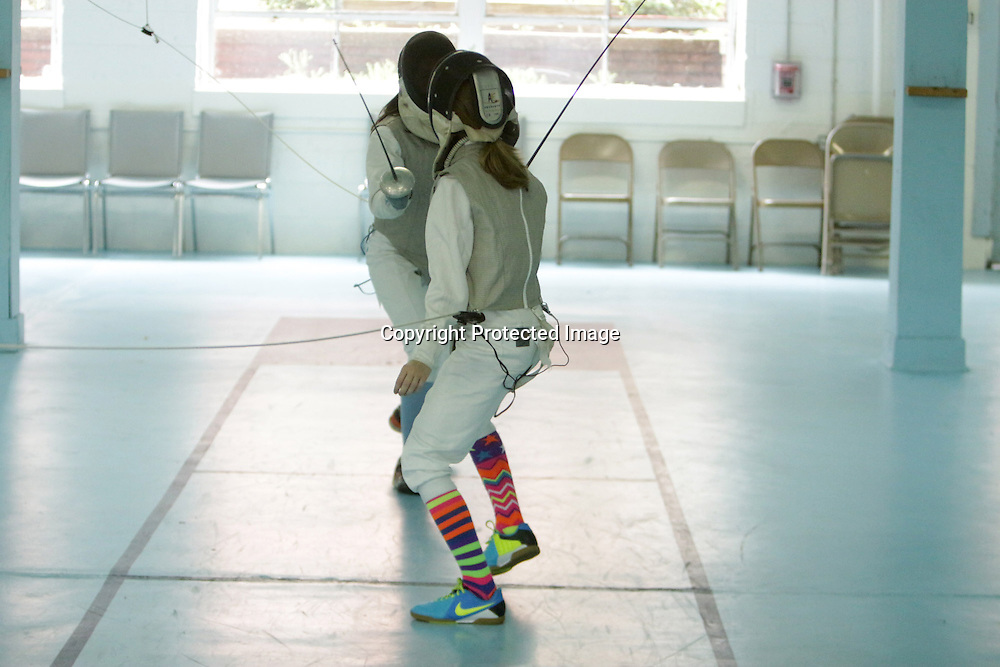 The Cape Fear Fencing Association held a youth fencing tournament at Tileston Gym in Wilmington, N.C. Saturday May 31, 2014. (Jason A. Frizzelle)