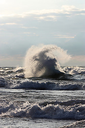 Two waves crashing into each other in Lake Michigan in New Buffalo