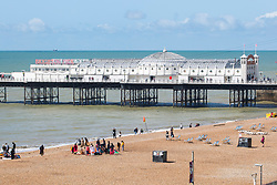 © Licensed to London News Pictures. 18/08/2019. Brighton, UK. A handful of visitors can be seen enjoying the beach in Brighton and Hove as sunny weather returns to the seaside resort. Photo credit: Hugo Michiels/LNP