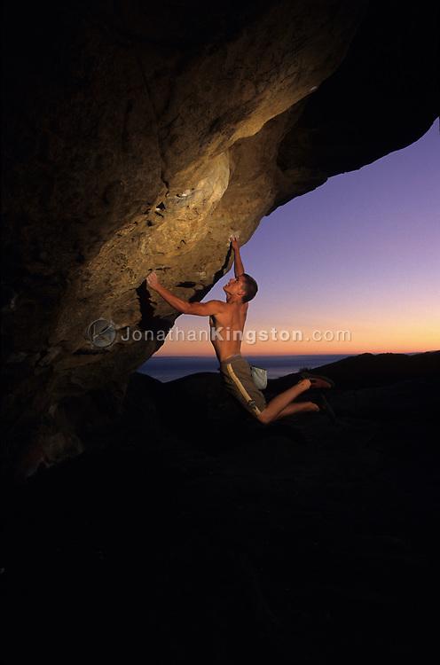 SANTA BARBARA, CA:  Brian Wysel rock climbs at the Lizards Mouth in Santa Barbara, California.  Lizards Mouth is a favorite area for local rock climbers and day hikers from Santa Barbara. (Model Released)
