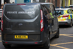 London, June 4th 2017. A private ambulance is escorted into the area by a police car during a massive policing operation in the aftermath of the terror attack on London Bridge and Borough Market on the night of June 3rd which left seven people dead and dozens injured