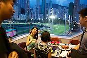 Guests enjoy dinner at the Hong Kong Jockey Club.