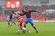 Doncaster Rovers defender Joe Wright (15) and Scunthorpe United forward Lee Novak (17)  during the EFL Sky Bet League 1 match between Doncaster Rovers and Scunthorpe United at the Keepmoat Stadium, Doncaster, England on 17 September 2017. Photo by Ian Lyall.