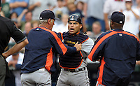 Detroit Tigers catcher Ivan Rodriguez(facing), who was thrown out of the game by home plate umpire Mike Winters, is restrained by his coaches as he yells heading to the dugout in the fourth inning of today's MLB baseball game against the Seattle Mariners in Seattle on Thursday, July 12, 2007. (AP Photo/Kevin P. Casey)