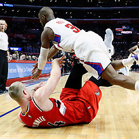12 December 2016: LA Clippers guard Chris Paul (3) dives for the loose ball over Portland Trail Blazers center Mason Plumlee (24) during the LA Clippers 121-120 victory over the Portland Trail Blazers, at the Staples Center, Los Angeles, California, USA.