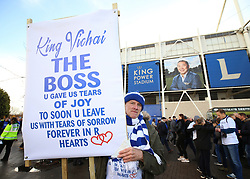 A Leicester City fan pays their respects to Vichai Srivaddhanaprabha with a banner outside the King Power Stadium