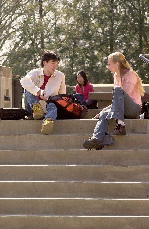 16398Spring Campus Shots              ..Keita Muchizuki talks with Jessica Haase on the steps of Gordy