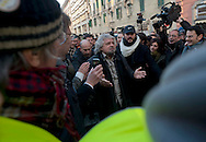 Roma, 11 Gennaio 2013.Beppe Grillo  del Movimento 5 Stelle  attorniato  da giornalisti e fan in piazza del Viminale in occasione della consegna dei contrassegni elettorali