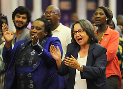 December 9, 2013 - Cape Town, Western Cape, South Africa - The City of Cape Town hosted an Evening of Remembrance at the OR Tambo hall, Khayelitsha for the late former President of South Africa, Nelson Mandela. MILDRED OLIPHANT, Minister of Labour, and the Executive Mayor of Cape Town, PATRICIA DE LILLE, sing struggle songs. (Credit Image: © Roger Sedres/Images SA/ZUMAPRESS.com)