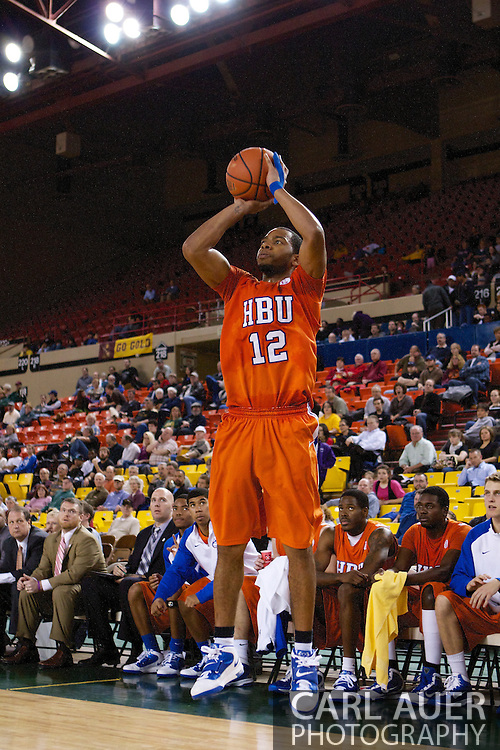 November 25th, 2010:  Anchorage, Alaska - Houston Baptist guard Michael Moss (12) attempts a three point shot in the Huskies loss to the Arizona State Sun Devils 73-55 in their first round game of the Great Alaska Shootout.