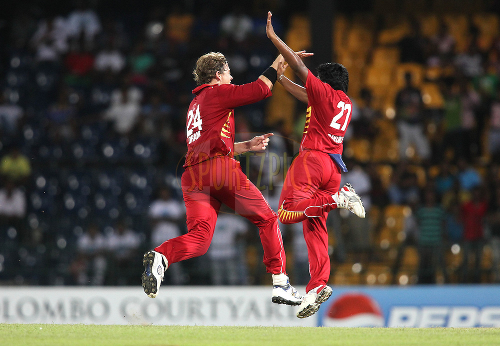 Jacob Oram of Uva Next celebrates with Bhanuka Rajapakse of Uva Next after getting Abdul Razzaq of Wayamba United wicket during the first Semi Final Match of the Sri Lankan Premier League between Uva Next and Wayamba United held at the Premadasa Stadium in Colombo, Sri Lanka on the 28th August 2012. .Photo by Shaun Roy/SPORTZPICS/SLPL