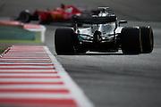 February 26, 2017: Circuit de Catalunya. Lewis Hamilton (GBR), Mercedes AMG Petronas Motorsport, F1 W08 chases Kimi Raikkonen's Scuderia Ferrari, SF70H