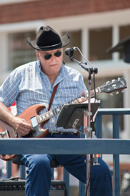 A musician plays guitar during the 2010 Pitman NJ annual 4th of July parade held on Monday July 5th.